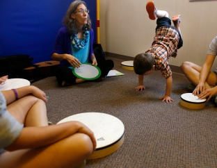 Collab for Kids. drumming. handstand